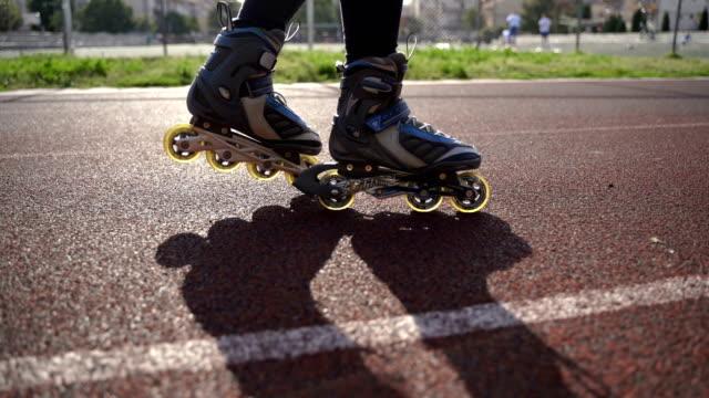teenage girl rollerskating in park.close up video