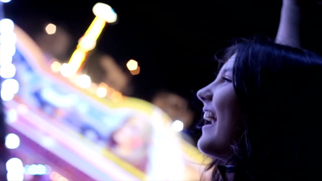 teenage girl screaming on carousel,close up - roller coaster stock videos & royalty-free footage