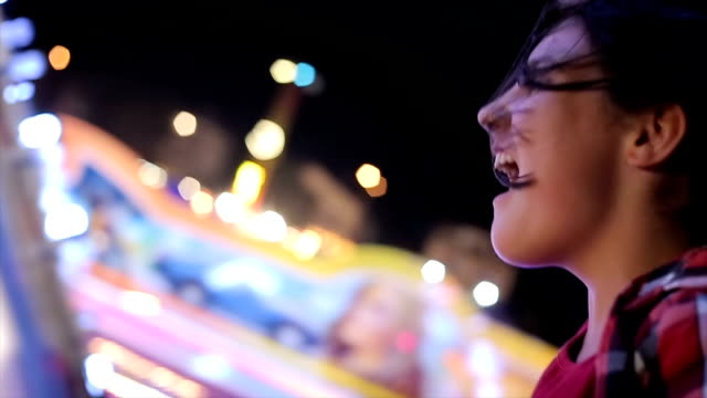 Teenage girl screaming on carousel,close up