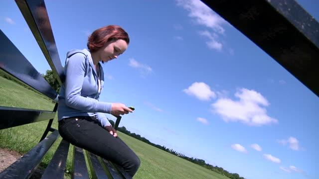 Teenage girl sending SMS video
