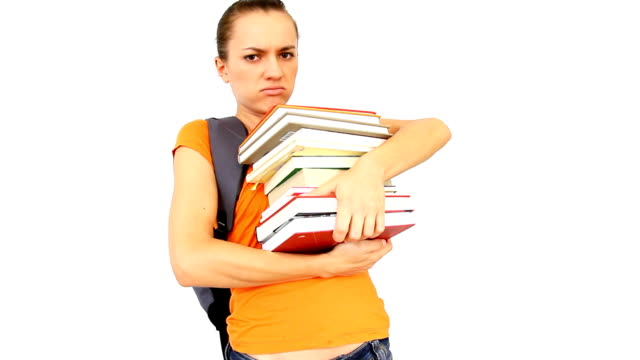 Teenage girl struggling with stack of books video