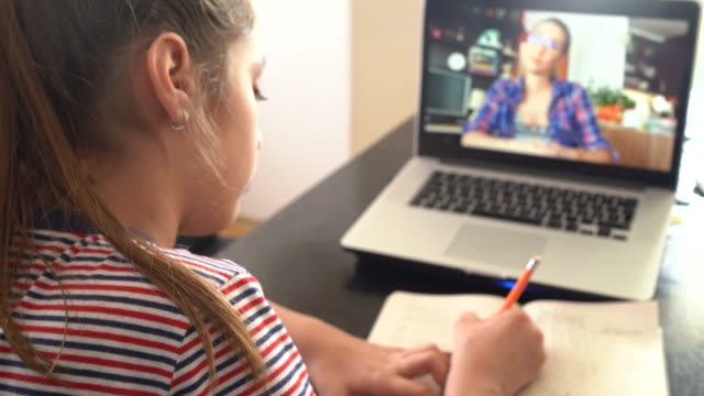 4k teenage girl studying with video online lesson at home   family in isolation - lockdown filmów i materiałów b-roll