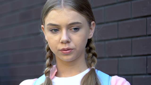 Teenage girl suffering migraine, psychological stress, victim of school bullying