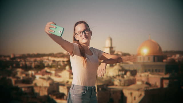 Teenage girl taking selfie in the background Dome of the Rock, Jerusalem, Israel video