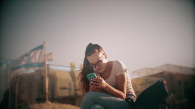 Teenage girl using smart phone in Jerusalem Old City video