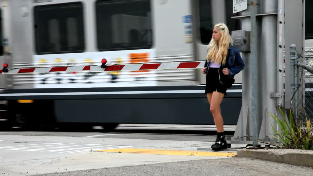 teenage girl waits then crosses street video