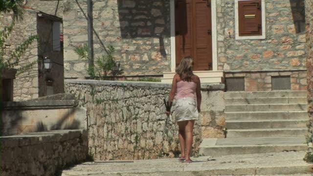 Teenage girl walking on street video