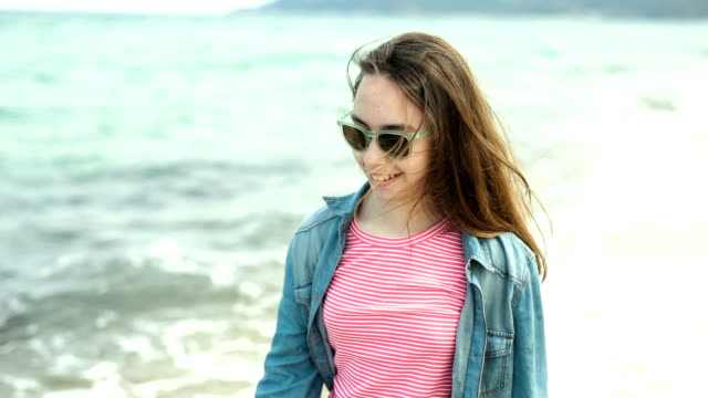 Teenage girl walking on the beach video