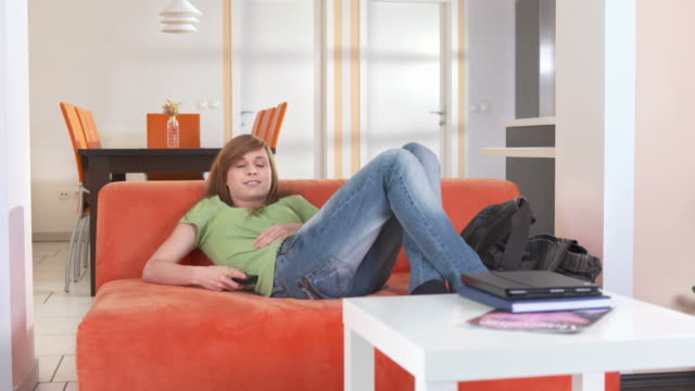 HD DOLLY: Teenage Girl Watching TV video