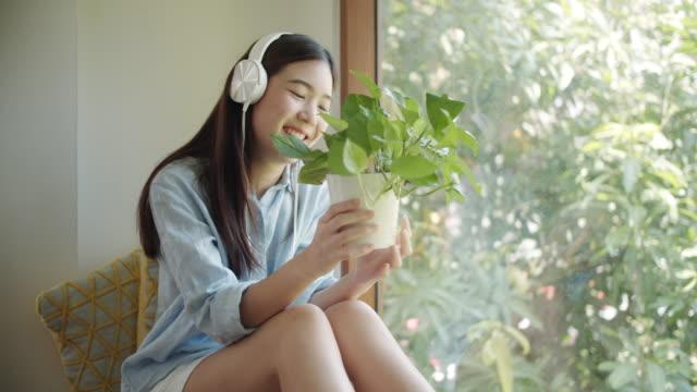 Teenage girl with potting plants