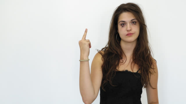 Teenage Girl With Ruined Make up From Crying Gesturing Fuck Off Sign Studio Shot Teenage Girl With Ruined Make up From Crying Gesturing Fuck Off Sign Studio Shot middle finger stock videos & royalty-free footage