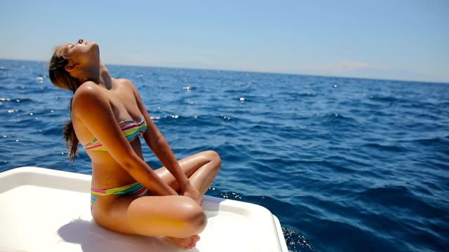 Teenage girls relaxing on sailboat video