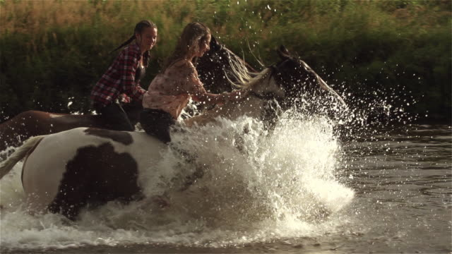 Teenage Girls Riding Horse River Splash Freedom SuperSlow Motion 4K video