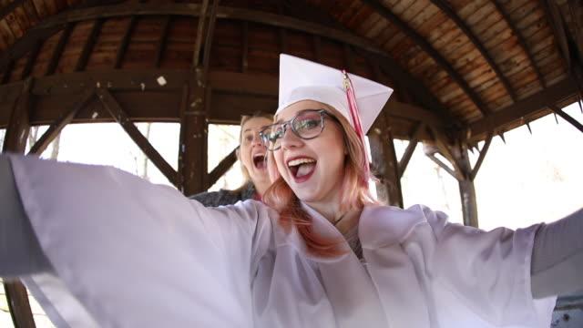Teenage Graduate Gets Photobombed During Selfie