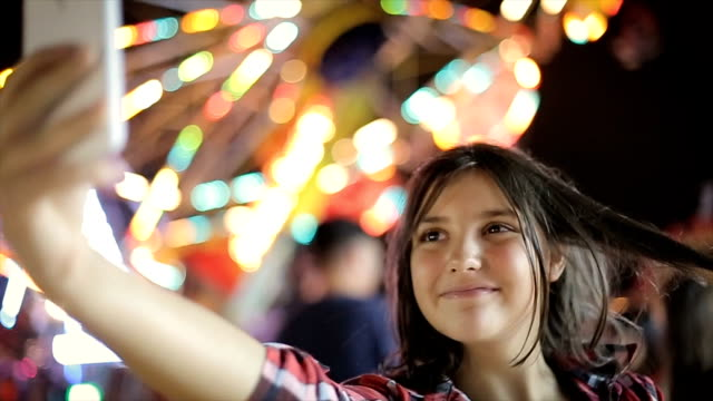 Teenage lifestyle,girl makes selfie with mobile phone and sharing on social network
