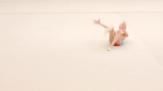 teenage rhythmic gymnastics athlete practicing with cool attitude - niedoskonałość filmów i materiałów b-roll