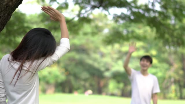 Teenage waving goodbye at outdoors in green park. Teenage waving goodbye at outdoors in green park. goodbye single word stock videos & royalty-free footage