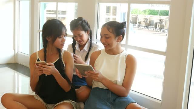 teenage women using smart phone in university video