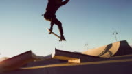 istock A Teenaged Caucasian Boy Performs a Regular Foot Ollie Over a Gap with His Skateboard at the Skatepark 1069000230