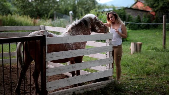 Teenagegirl with horse outside