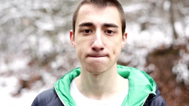 Teenager boy posing and looking at camera video