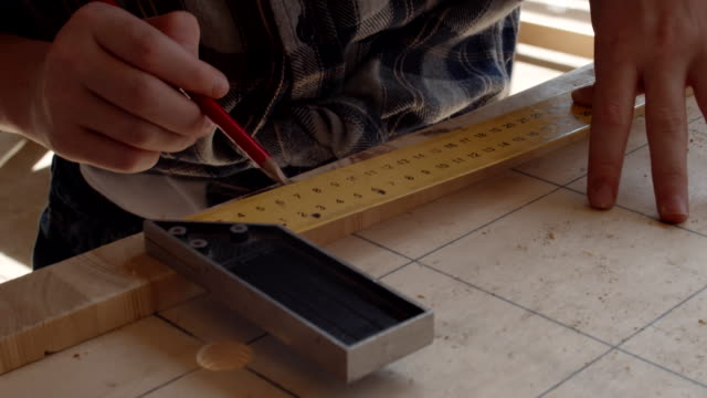 Teenager Drafting in Carpentry Shop