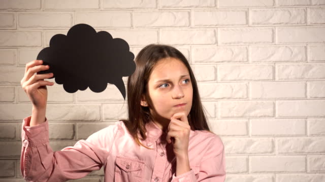 Teenager girl thinking about something Teenager girl thinking about something with black mind cloud in hands prop stock videos & royalty-free footage