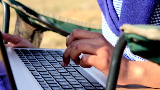 Teenager girl using laptop outdoor in nature