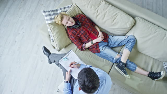 Teenager Lying on Sofa during Psychotherapy video