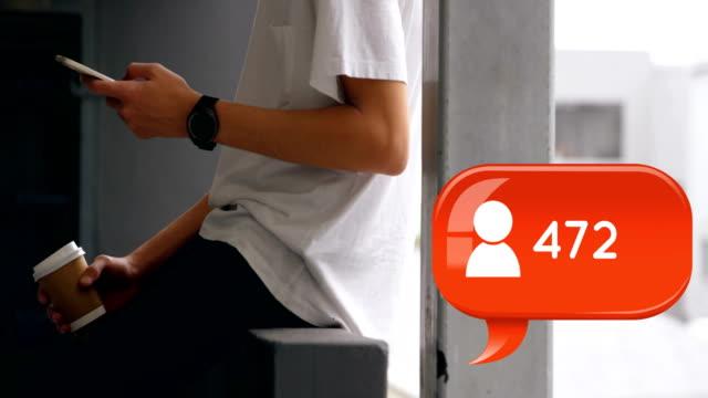 Teenager sitting on a veranda rail texting 4k