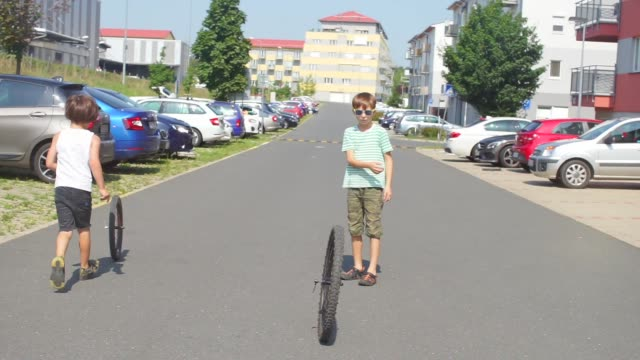 teenager started a bicycle wheel