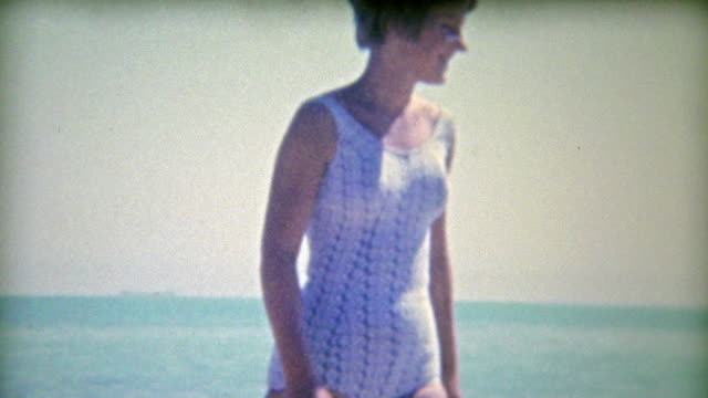 1956: Teenagers first boat trip with 2 tan men. video