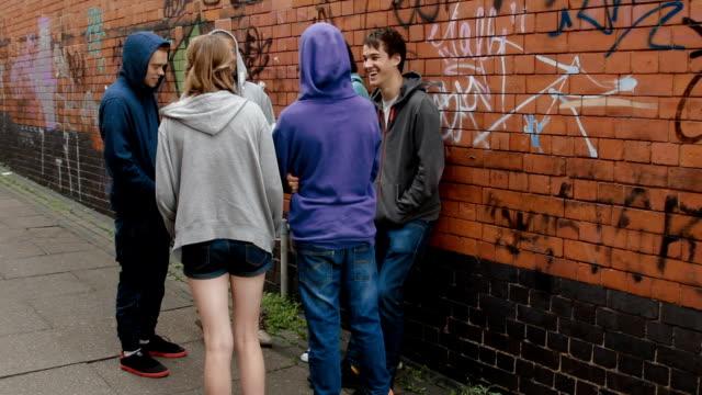 pov: teenager, die passanten geworfen, einschüchternd - rebellion stock-videos und b-roll-filmmaterial