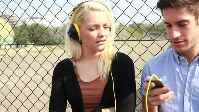 Teenagers listening to music video