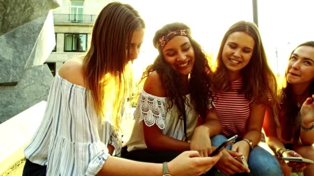 teens friends using the technology outdoors video