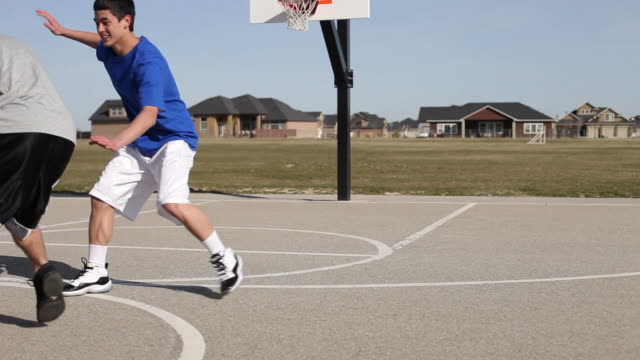 Teens play basketball video