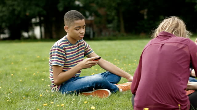 Teens playing on cell phones video