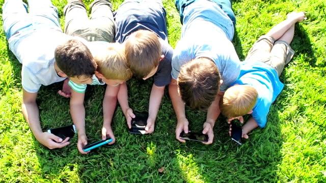 Teens using mobile phone