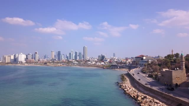 Tel Aviv and Jaffa skyline, aerial view above the old city and port of Jaffa and TLV coastline in the background.