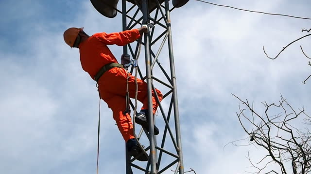 Telecommunication high worker on tower video