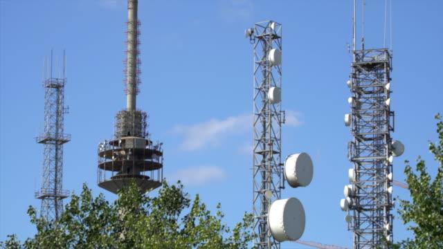 Telecommunication mast TV antennas wireless technology with blue sky video