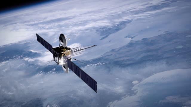 telecommunication satellite 2. cinema quality 3d animation. hd. - satellitbild bildbanksvideor och videomaterial från bakom kulisserna
