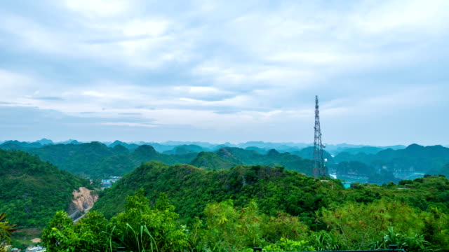 telecommunications tower on mountain with cloudy sky, time lapse - spranga video stock e b–roll