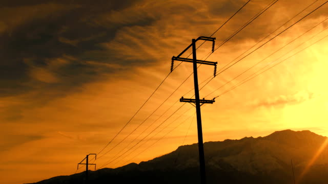Telephone pole Sunse Timelapse HD 1080i timelapse shot of a telephone pole against a sunset. power supply stock videos & royalty-free footage