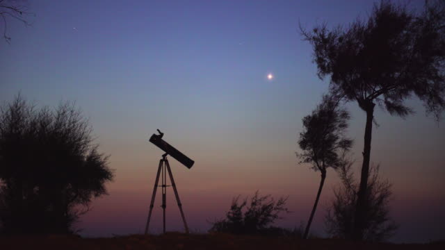 Telescope ready for observation at dusk