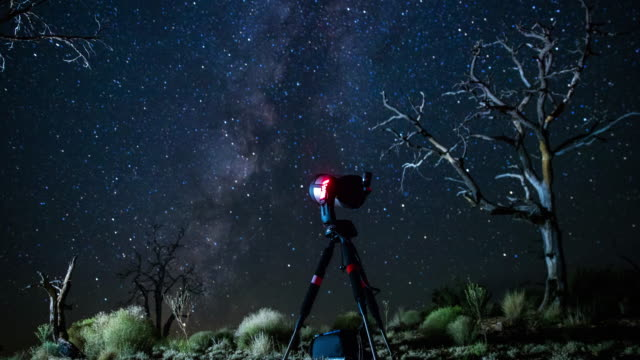 Telescope Watching Milky Way Over Mojave National Preserve - Time Lapse Night time lapse shot in August in Mojave National Preserve, a remote area of desert in Southern California, during the Perseid Meteor Shower. An unattended telescope is tracking the Milky Way across the sky. mojave desert stock videos & royalty-free footage