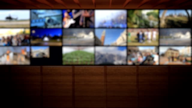 stockvideo's en b-roll-footage met television studio. blurred background - studio