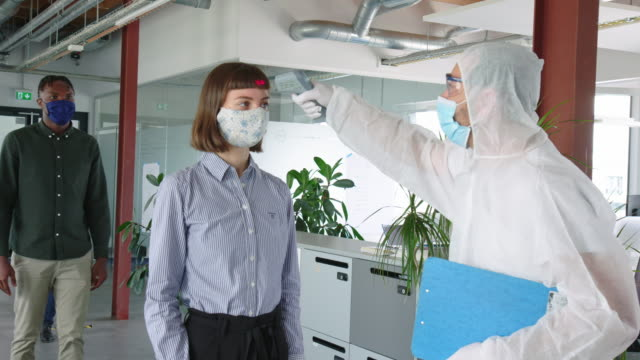 Temperature checks in office for scanning corona virus symptoms