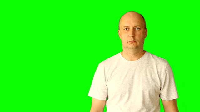 Template transparent background. Man is showing gestures on a green screen. Gestures with head, hands, fingers yes there is no exact attention here. Scroll swipe and touches the virtual screen. video