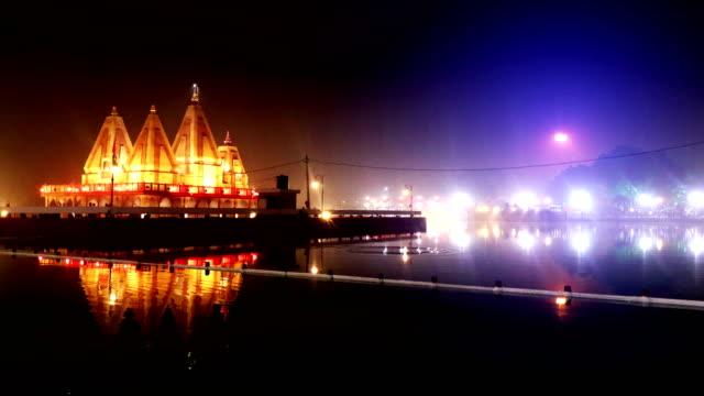 temple at night illuminated during international geeta festival - харьяна стоковые видео и кадры b-roll